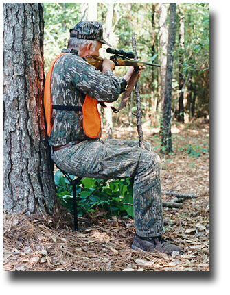 deer hunter sitting on the 16 inch seat